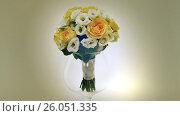 Купить «A wedding bouquet of yellow roses, eustoma and eucalyptus greens.. Bouquet in rotation.», видеоролик № 26051335, снято 22 апреля 2017 г. (c) Mikhail Davidovich / Фотобанк Лори