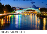 Купить «Bridge of Peace at night in Tibilisi, Georgia», фото № 26051611, снято 24 сентября 2016 г. (c) Elena Odareeva / Фотобанк Лори