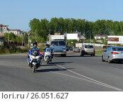 Купить «Офицеры моторизованного подразделения дорожно-патрульной службы полиции на трассе», фото № 26051627, снято 14 мая 2016 г. (c) Free Wind / Фотобанк Лори
