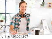Купить «Young man working in office», фото № 26051967, снято 14 декабря 2014 г. (c) Sergey Nivens / Фотобанк Лори