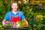 Businessman gardener with grown flowers in a greenhouse, фото № 26054387, снято 15 июля 2016 г. (c) Константин Лабунский / Фотобанк Лори