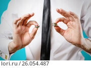 Купить «Close up. Businessman hands compare two piles of coins of different sizes, indicating the return on investment. Isolated on white background», фото № 26054487, снято 18 апреля 2017 г. (c) Виктория Кузьменкова / Фотобанк Лори