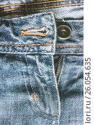 Купить «Denim pants to unfasten the zipper close-up», фото № 26054635, снято 21 марта 2017 г. (c) Tetiana Chugunova / Фотобанк Лори