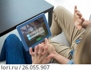 Купить «Couple with tablet on the sofa. Screen with login», фото № 26055907, снято 19 августа 2018 г. (c) Wavebreak Media / Фотобанк Лори