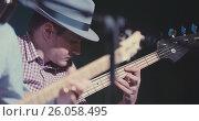 Купить «Blues in night club - guitarist plays guitar, close up», фото № 26058495, снято 26 апреля 2018 г. (c) Константин Шишкин / Фотобанк Лори