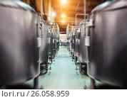 Купить «Rows of steel tanks for beer fermentation and maturation», фото № 26058959, снято 17 января 2013 г. (c) Андрей Радченко / Фотобанк Лори