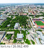Купить «Aerial city view with crossroads and roads, houses, buildings, parks and parking lots. Sunny summer panoramic image», фото № 26062499, снято 21 января 2020 г. (c) Александр Маркин / Фотобанк Лори