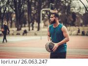 Купить «African-american streetball player practicing outdoors», фото № 26063247, снято 7 апреля 2017 г. (c) Andrejs Pidjass / Фотобанк Лори