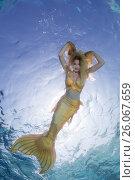 Купить «Golden-haired mermaid swims under the water, Indian Ocean, Maldives», фото № 26067659, снято 24 марта 2017 г. (c) Некрасов Андрей / Фотобанк Лори