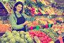 Smiling girl seller is showing assortment, фото № 26077679, снято 18 марта 2017 г. (c) Яков Филимонов / Фотобанк Лори