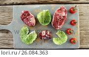 Купить «Marinated steak and vegetables on chopping board», видеоролик № 26084363, снято 6 декабря 2019 г. (c) Wavebreak Media / Фотобанк Лори