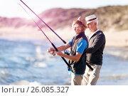 Купить «Senior man fishing with his grandson», фото № 26085327, снято 15 апреля 2015 г. (c) Sergey Nivens / Фотобанк Лори