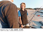 Купить «Senior man fishing with his grandson», фото № 26085335, снято 15 апреля 2015 г. (c) Sergey Nivens / Фотобанк Лори
