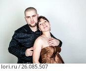 Купить «Man and woman hugging on a gray background», фото № 26085507, снято 26 февраля 2016 г. (c) Александр Калугин / Фотобанк Лори
