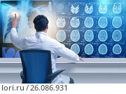 Купить «Male doctor looking at MRI scans», фото № 26086931, снято 22 мая 2019 г. (c) Elnur / Фотобанк Лори