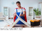 Купить «Super hero repairman working at home», фото № 26087127, снято 23 декабря 2016 г. (c) Elnur / Фотобанк Лори