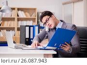 Купить «Businessman working in the office», фото № 26087943, снято 16 января 2017 г. (c) Elnur / Фотобанк Лори