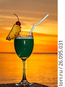 Glass of drink is on a beach table. Стоковое фото, фотограф М / Фотобанк Лори