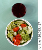 Sherry juice and salad from tomatoes, cucumbers and herbs. Стоковое фото, фотограф Олег Безруков / Фотобанк Лори