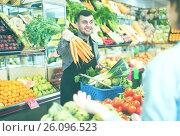 Купить «Male seller assisting in buying», фото № 26096523, снято 18 марта 2017 г. (c) Яков Филимонов / Фотобанк Лори