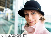 Купить «Tilburg, Netherlands. Young adult caucasian female waiting for her intercity train to take her to her work assignment as a musci teacher.», фото № 26098171, снято 17 марта 2017 г. (c) age Fotostock / Фотобанк Лори
