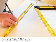 Купить «Man draws with a pencil», фото № 26107235, снято 26 марта 2013 г. (c) Анна Гучек / Фотобанк Лори