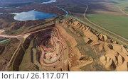 Купить «Panorama of the quarry. Artificial lake. Sunset. Horizon. Development of minerals.», видеоролик № 26117071, снято 30 марта 2017 г. (c) Вячеслав Позднышев / Фотобанк Лори