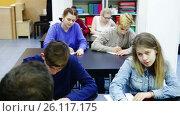 Купить «Group of students listening to teacher explaining material in class», видеоролик № 26117175, снято 13 марта 2017 г. (c) Яков Филимонов / Фотобанк Лори