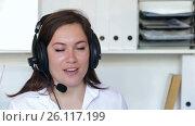 Купить «Female employee having a productive day at call-centre», видеоролик № 26117199, снято 17 апреля 2017 г. (c) Яков Филимонов / Фотобанк Лори