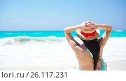 Купить «Back view of beautiful woman in hat on summer holidays on white beach», видеоролик № 26117231, снято 26 апреля 2017 г. (c) Дмитрий Травников / Фотобанк Лори