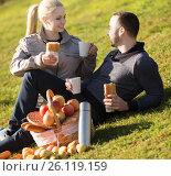 Купить «Couple lounging at picnic outdoors», фото № 26119159, снято 17 ноября 2018 г. (c) Яков Филимонов / Фотобанк Лори