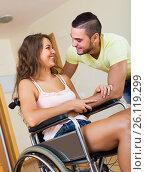 Купить «Smiling couple with disabled spouse», фото № 26119299, снято 26 марта 2019 г. (c) Яков Филимонов / Фотобанк Лори
