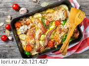 Rabbit meat baked with sour cream and tomatoes, peppers, garlic, Стоковое фото, фотограф Oksana Zh / Фотобанк Лори