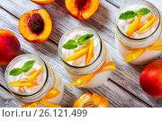 Купить «Delicious homemade yogurt with pieces of peach, top view», фото № 26121499, снято 22 августа 2015 г. (c) Oksana Zh / Фотобанк Лори