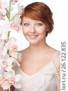 Young smiling woman with orchid. Стоковое фото, фотограф Tatjana Romanova / Фотобанк Лори