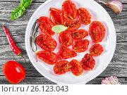Купить «Italian sun dried tomatoes, close-up, top view», фото № 26123043, снято 14 октября 2015 г. (c) Oksana Zh / Фотобанк Лори