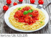 Купить «Tasty italian spahgetti with meatballs and tomato sauce, close-up», фото № 26123235, снято 16 января 2019 г. (c) Oksana Zh / Фотобанк Лори