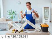 Купить «Repairman repairing broken chair at home», фото № 26138691, снято 28 ноября 2016 г. (c) Elnur / Фотобанк Лори