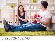 Купить «Romantic pair playing guitar on floor», фото № 26138743, снято 10 февраля 2017 г. (c) Elnur / Фотобанк Лори