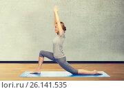 Купить «happy woman making yoga in low lunge on mat», фото № 26141535, снято 13 ноября 2015 г. (c) Syda Productions / Фотобанк Лори
