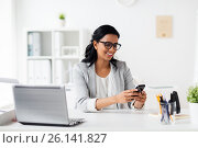 Купить «businesswoman with smartphone and laptop at office», фото № 26141827, снято 11 марта 2017 г. (c) Syda Productions / Фотобанк Лори