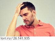 unhappy man suffering from head ache. Стоковое фото, фотограф Syda Productions / Фотобанк Лори