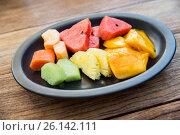 Купить «still life with exotic tropical fruits in bowl», фото № 26142111, снято 14 февраля 2015 г. (c) Syda Productions / Фотобанк Лори