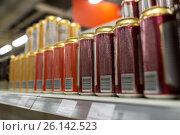Купить «close up of beer or cider cans at liquor store», фото № 26142523, снято 2 ноября 2016 г. (c) Syda Productions / Фотобанк Лори