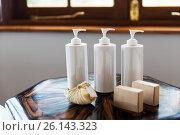 Купить «bottles with liquid soap or lotion at spa», фото № 26143323, снято 16 февраля 2016 г. (c) Syda Productions / Фотобанк Лори