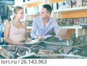 Young family couple selecting erotic video in discount. Стоковое фото, фотограф Яков Филимонов / Фотобанк Лори
