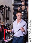 Купить «Man selecting bdsm toys in sex shop», фото № 26143967, снято 19 февраля 2020 г. (c) Яков Филимонов / Фотобанк Лори