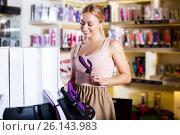 Купить «Female customer shopping sex toy», фото № 26143983, снято 19 февраля 2020 г. (c) Яков Филимонов / Фотобанк Лори