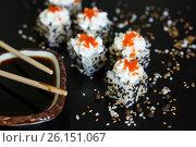 Fresh sushi rolls with soy sauce and chopsticks on black background. Стоковое фото, фотограф Галина Жигалова / Фотобанк Лори