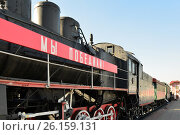 Купить «Moscow, Russia - April 1.2017. EM locomotive that says - we defeated - in Museum of History of Railway Transport Development», фото № 26159131, снято 1 апреля 2017 г. (c) Володина Ольга / Фотобанк Лори